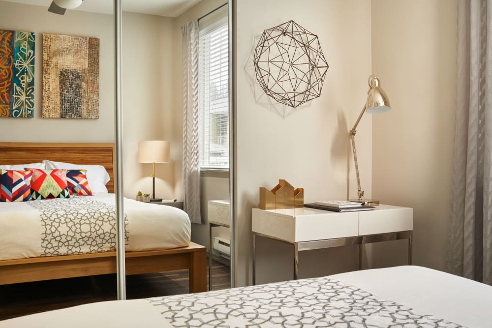 Large bedroom with mirrors on the closet doors at Brookside Village in Auburn, Washington