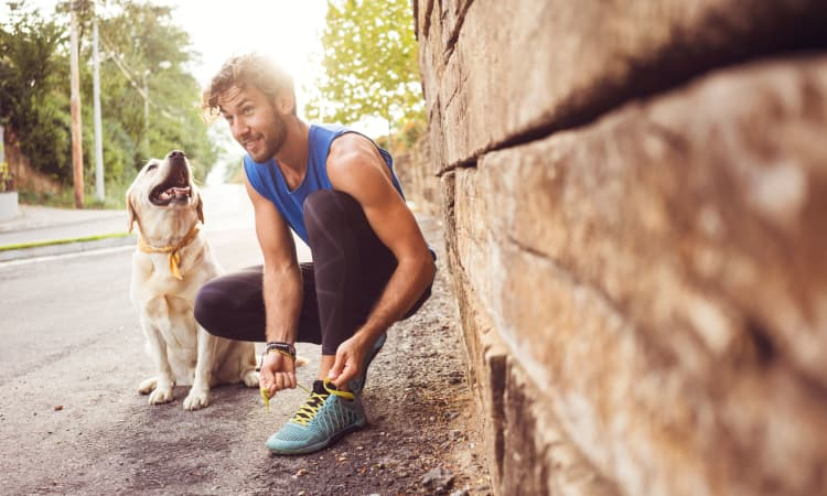 Resident and his puppy going on a run near The View at Lakeside in Lewisville, Texas