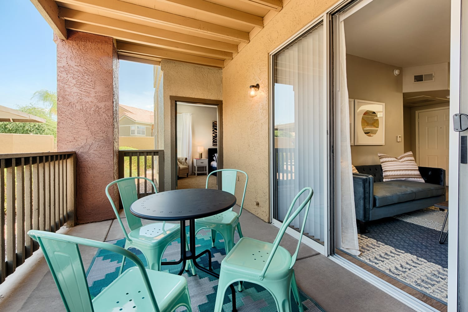 Enjoy a private patio off of your new living room at Sonoran Vista Apartments in Scottsdale, Arizona