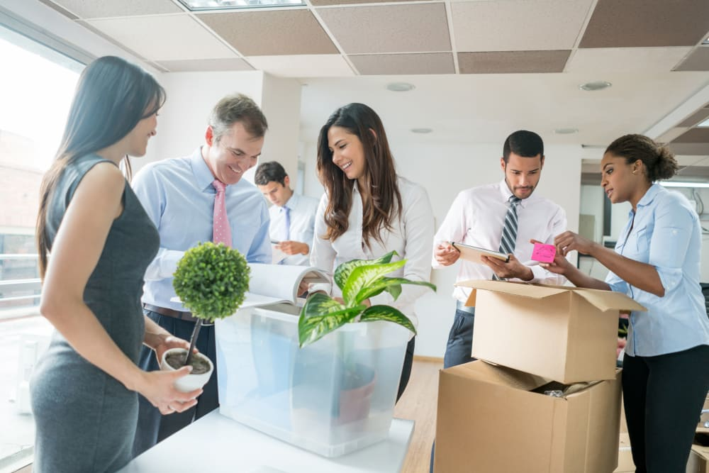 Employees packing boxed for business storage at Stor 4 Dayz in Sanford, Florida