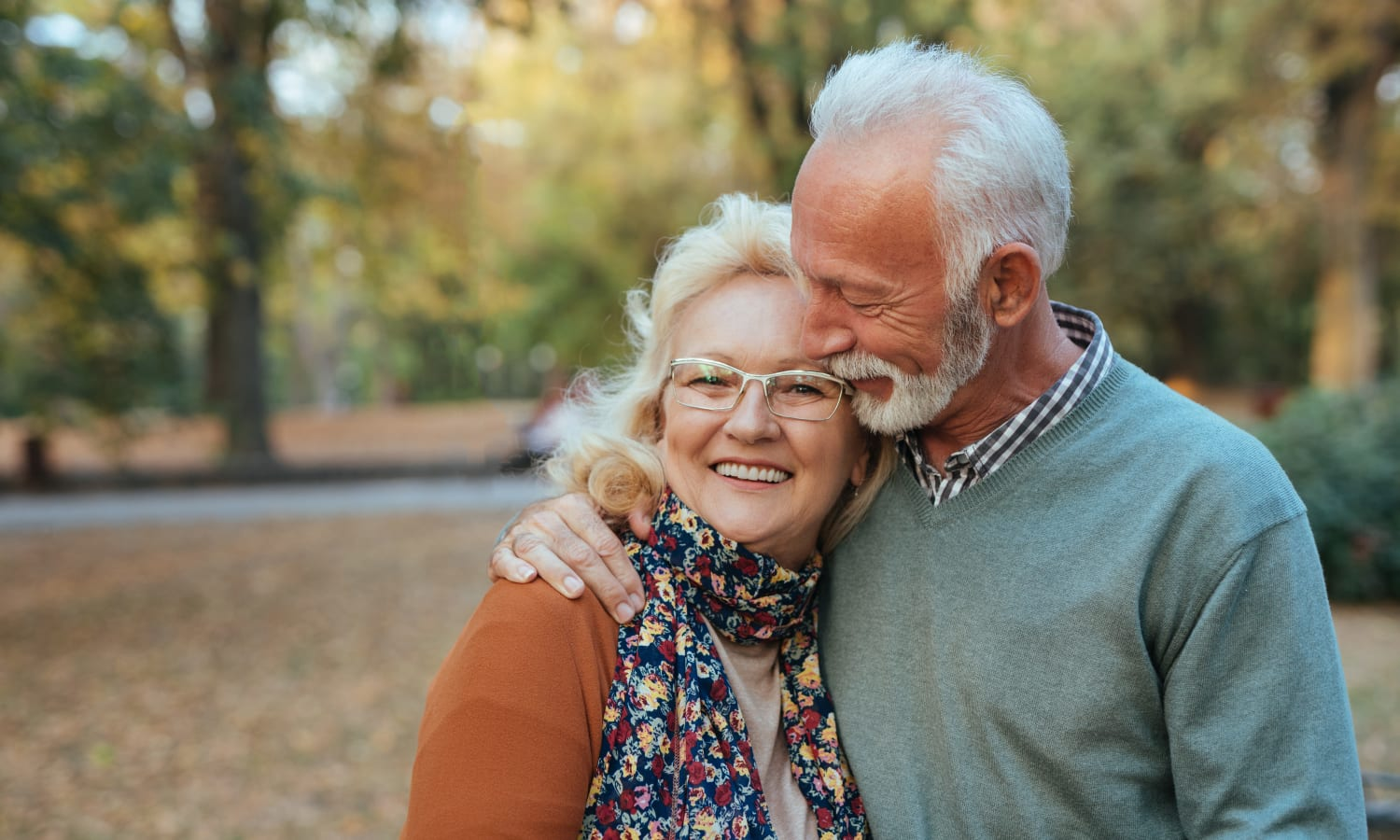 Senior couple embracing near Pioneer Village in Jacksonville, Oregon