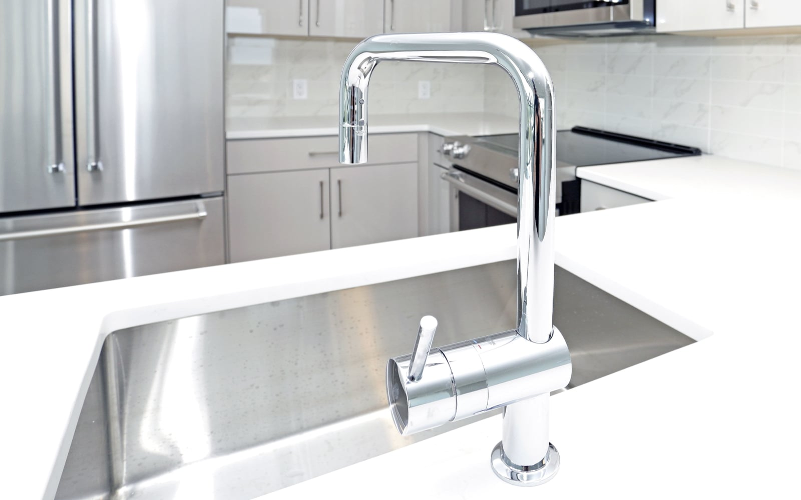 Shiny kitchen faucet inside of a The Centre home