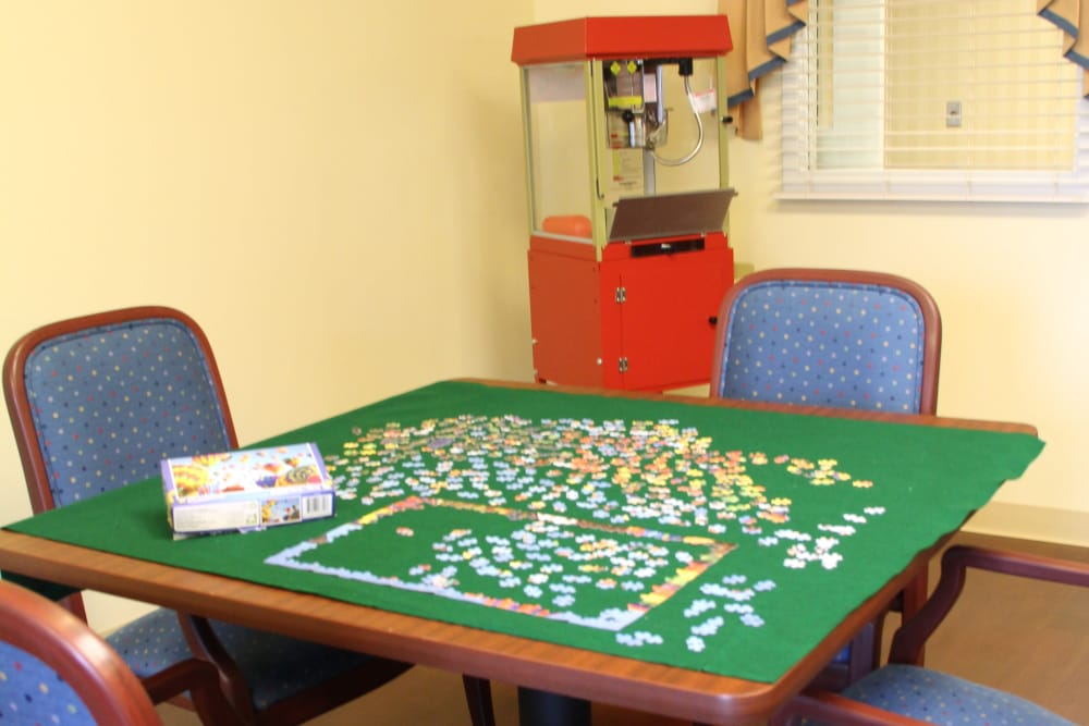 A puzzle and popcorn machine in the game room at The Willows at Howell in Howell, Michigan