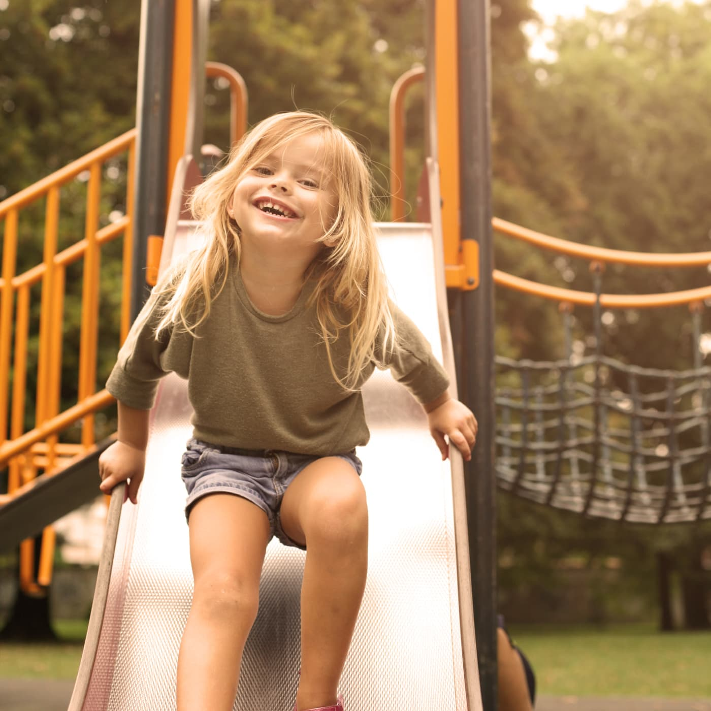 Girl having fun at a playground in Gaithersburg, MD near Stewartown Homes