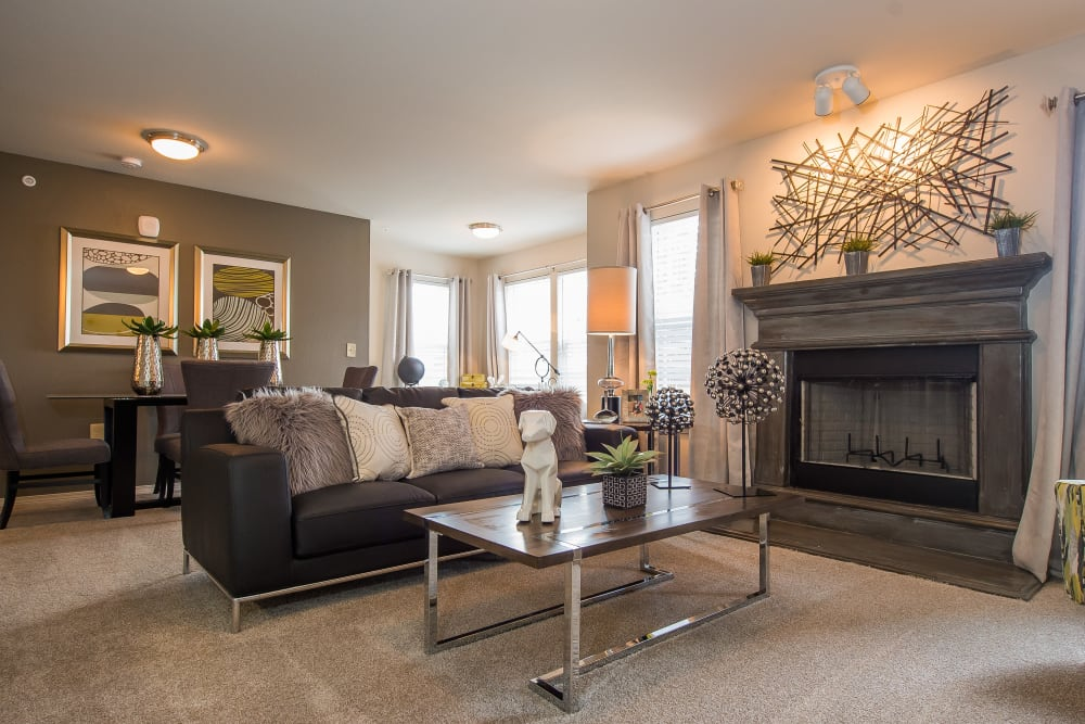 Spacious, bright living room with a fireplace at Scissortail Crossing Apartments in Broken Arrow, Oklahoma