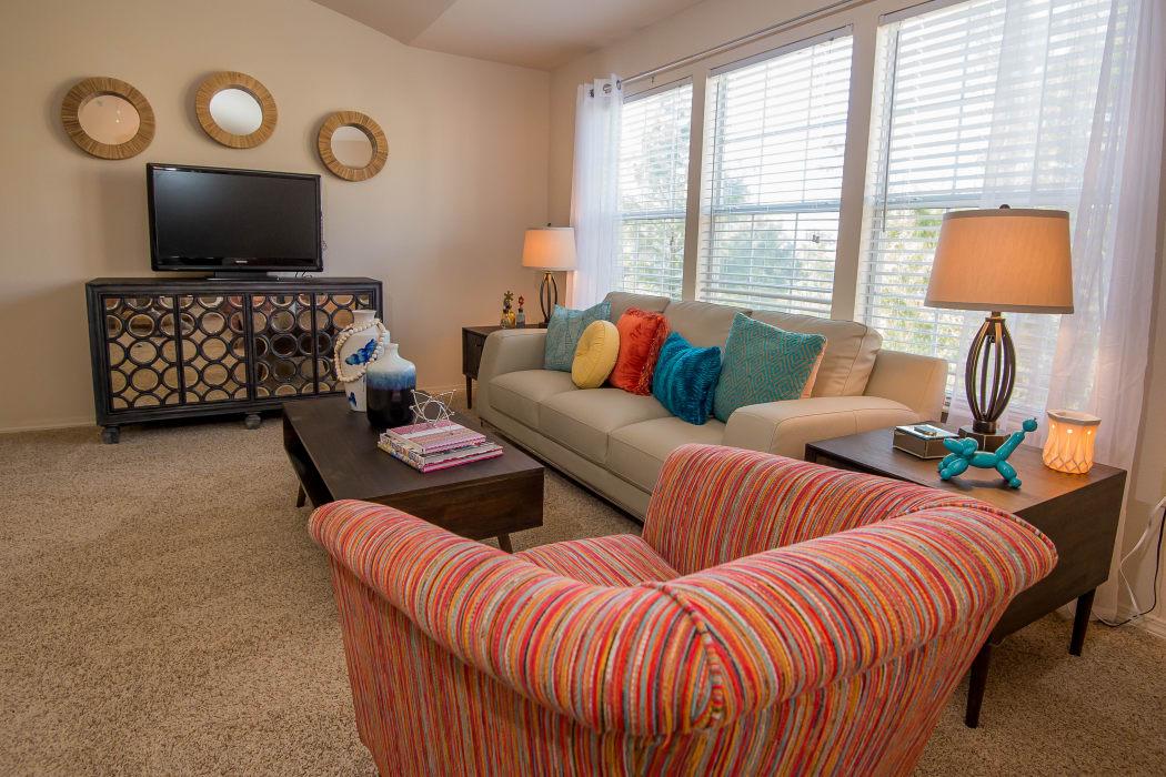 Well-lit living room at Villas at Aspen Park in Broken Arrow, Oklahoma
