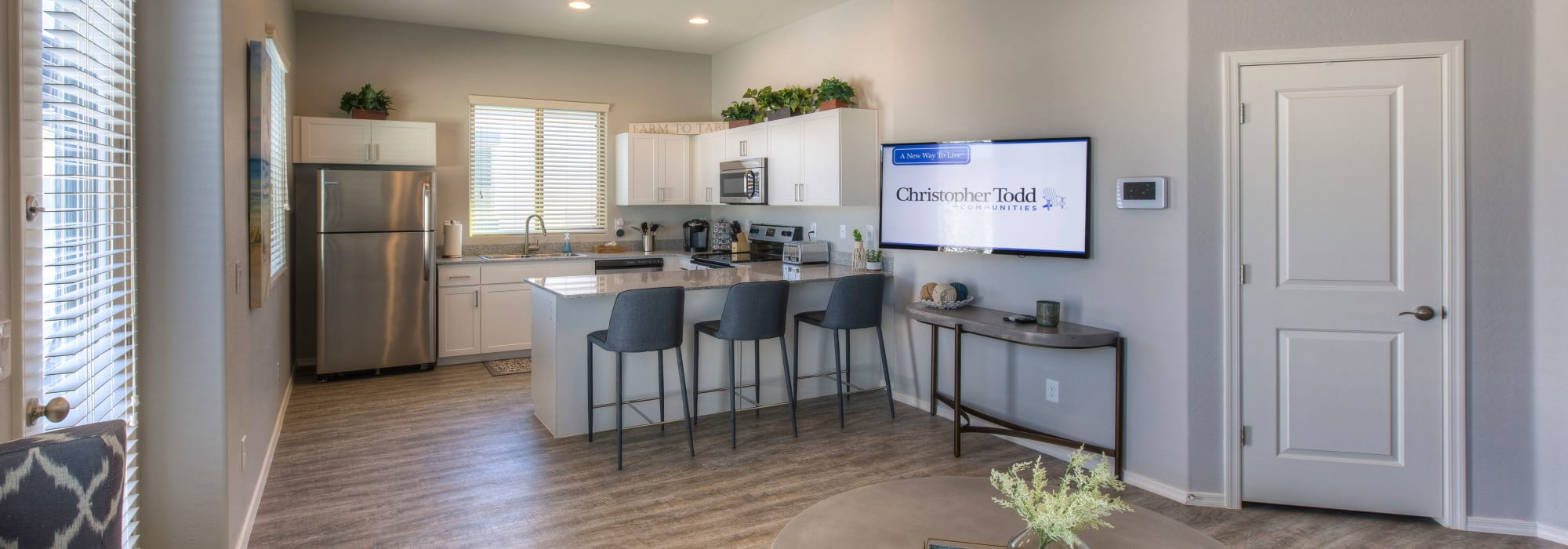 Hardwood floors in open-concept layout at Christopher Todd Communities at Country Place in Tolleson, Arizona