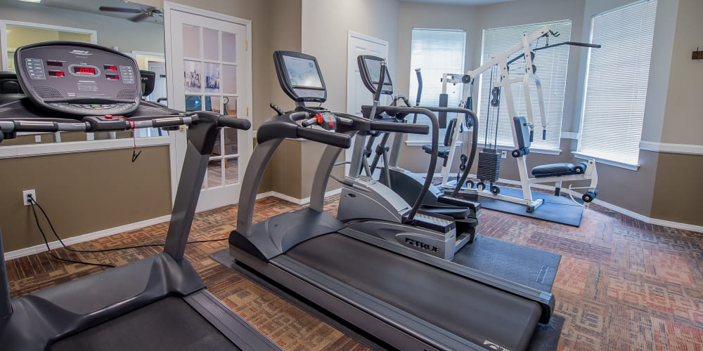Fully equipped fitness center at Crown Chase Apartments in Wichita, Kansas