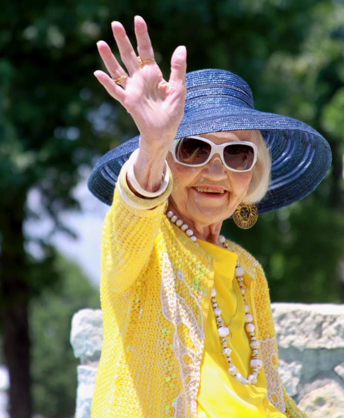 A woman waving at Trilogy Health Services in Louisville, Kentucky
