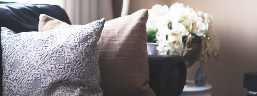 Comfortable pillows on a couch in an apartment at The Columbia at the Waterfront in Vancouver, Washington