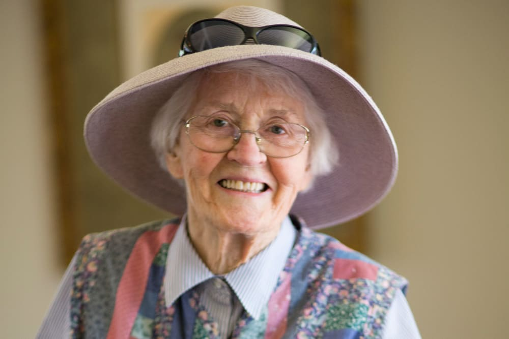 A smiling resident with a hat at Gables of Ojai in Ojai, California