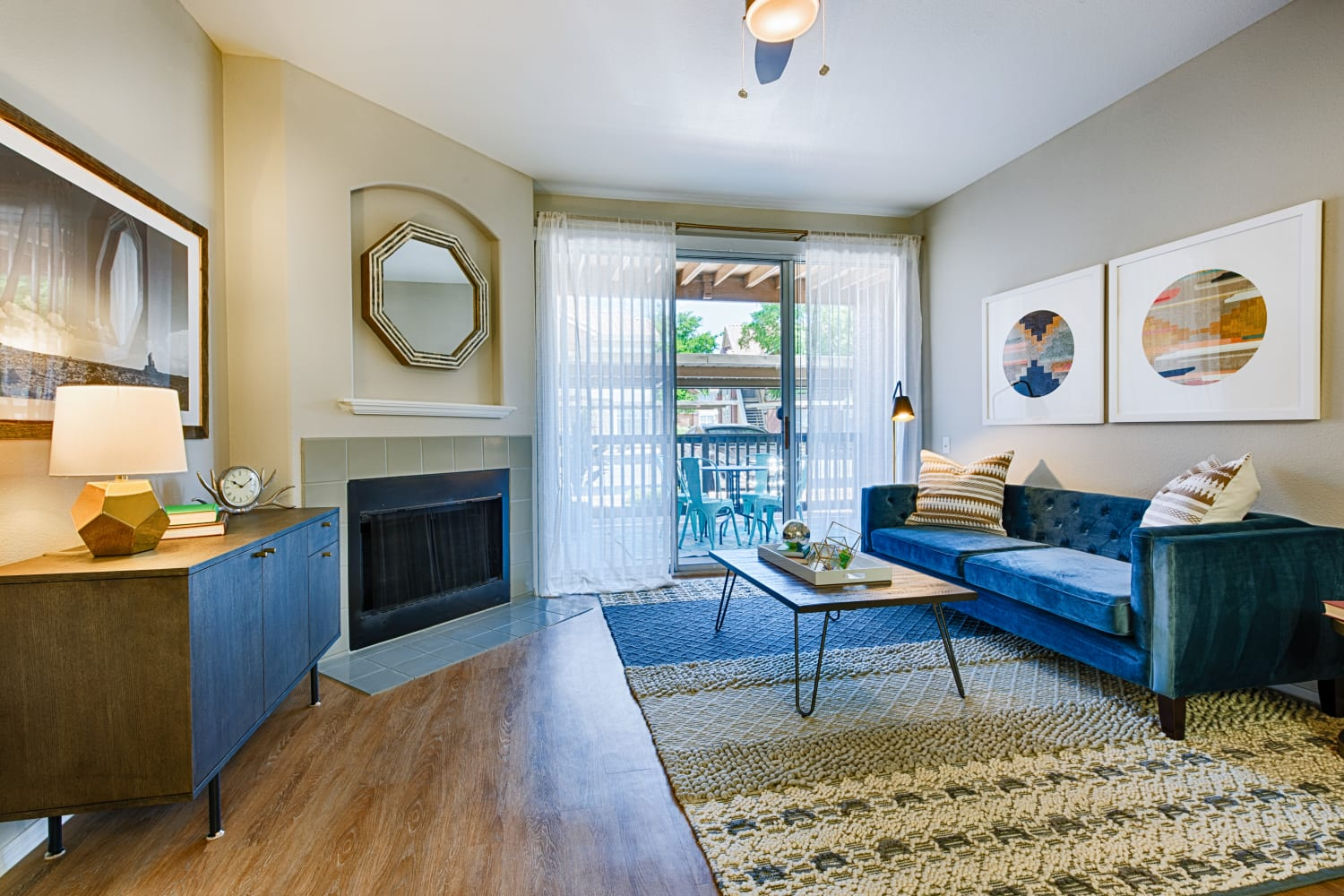 Sonoran Vista Apartments in Scottsdale, Arizona, offer living rooms with a fireplace, hardwood floors and private patio