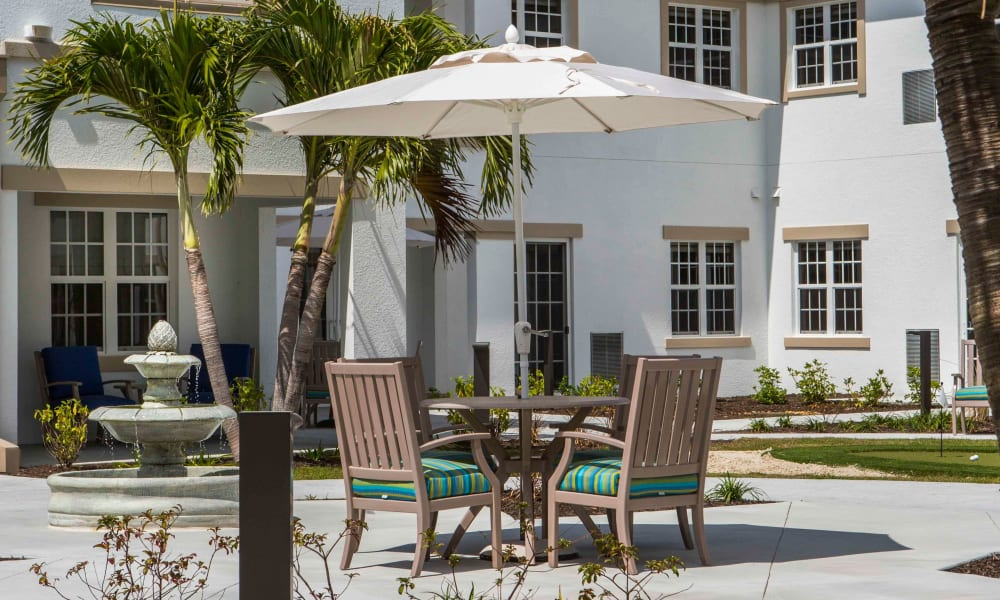Outdoor shaded seating at Beach House Assisted Living & Memory Care Naples in Naples, Florida
