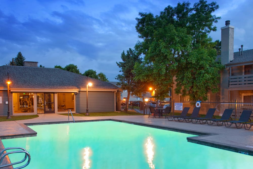 Luxurious community pool lit up in the early evening at Hampden Heights Apartments in Denver, Colorado