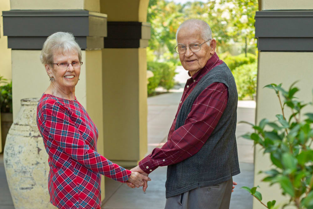 A resident couple holding hands at Merrill Gardens at Campbell in Campbell, California.