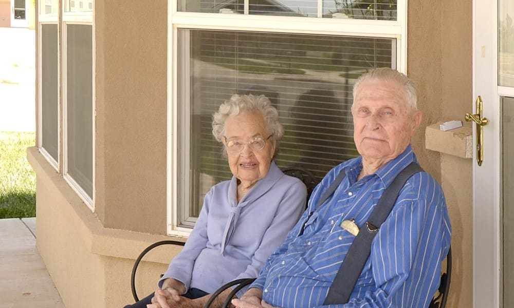 A couple of residents outside on patio at Wheatfields Senior Living Community in Clovis, New Mexico