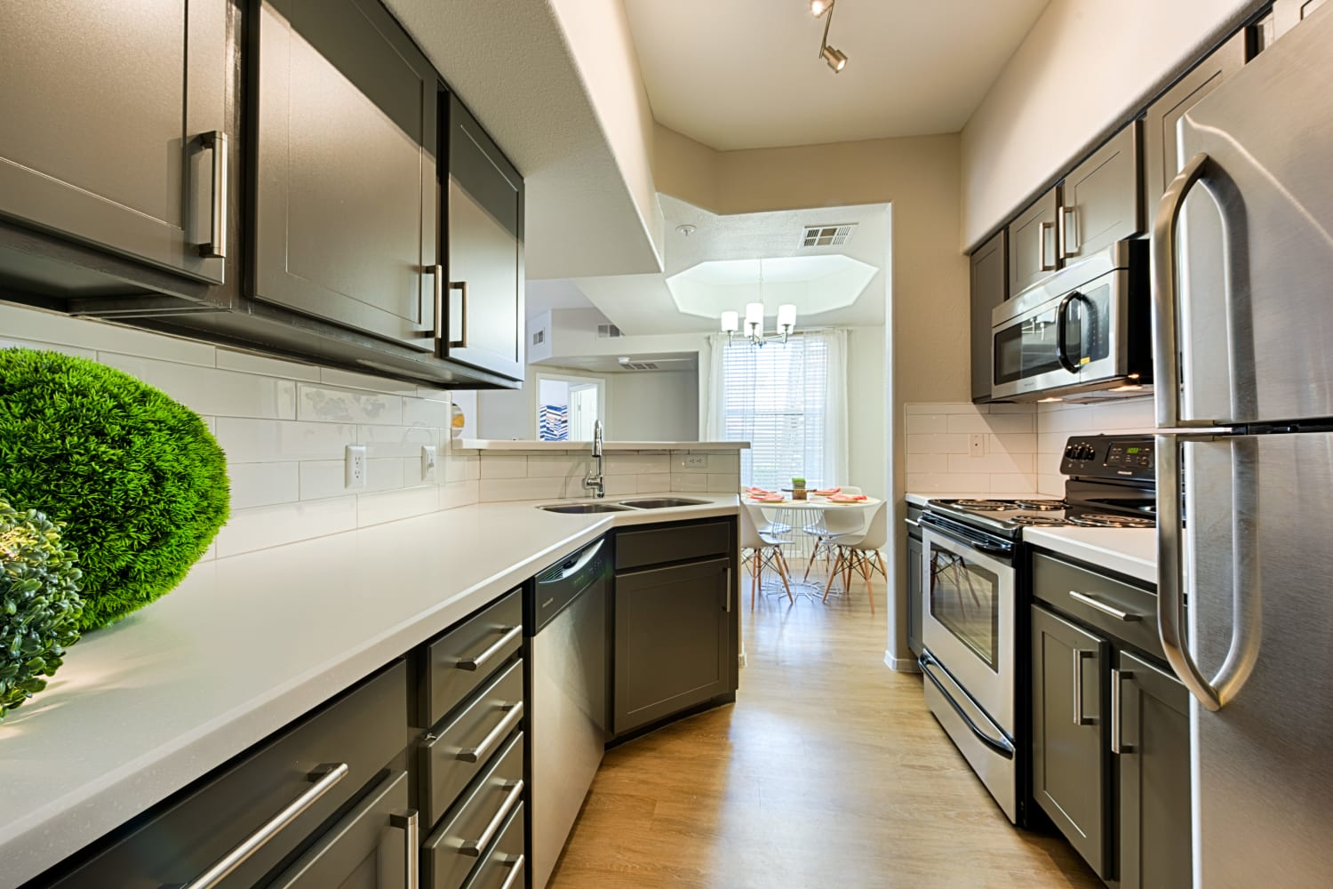 Modern kitchens with sleek black cabinetry at Sonoran Vista Apartments in Scottsdale, Arizona
