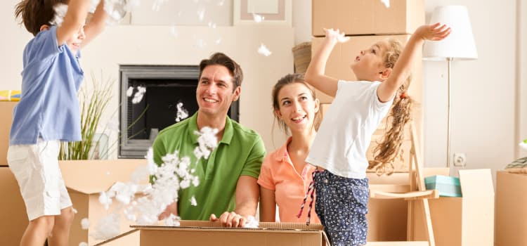 Happy family ready to move their belongings into a Fortress Storage Solutions location