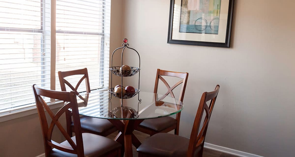 Naturally lit dining area at Greentree Apartments in Carrollton, Texas