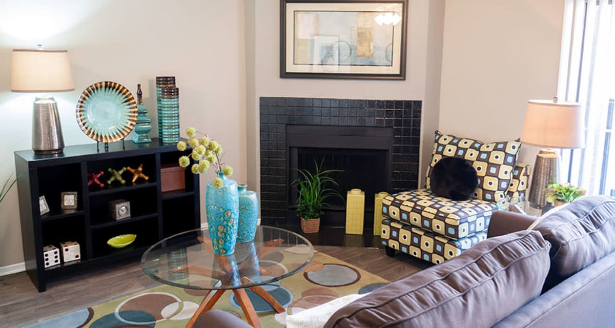 Fireplace in living room available at Greentree Apartments in Carrollton, Texas