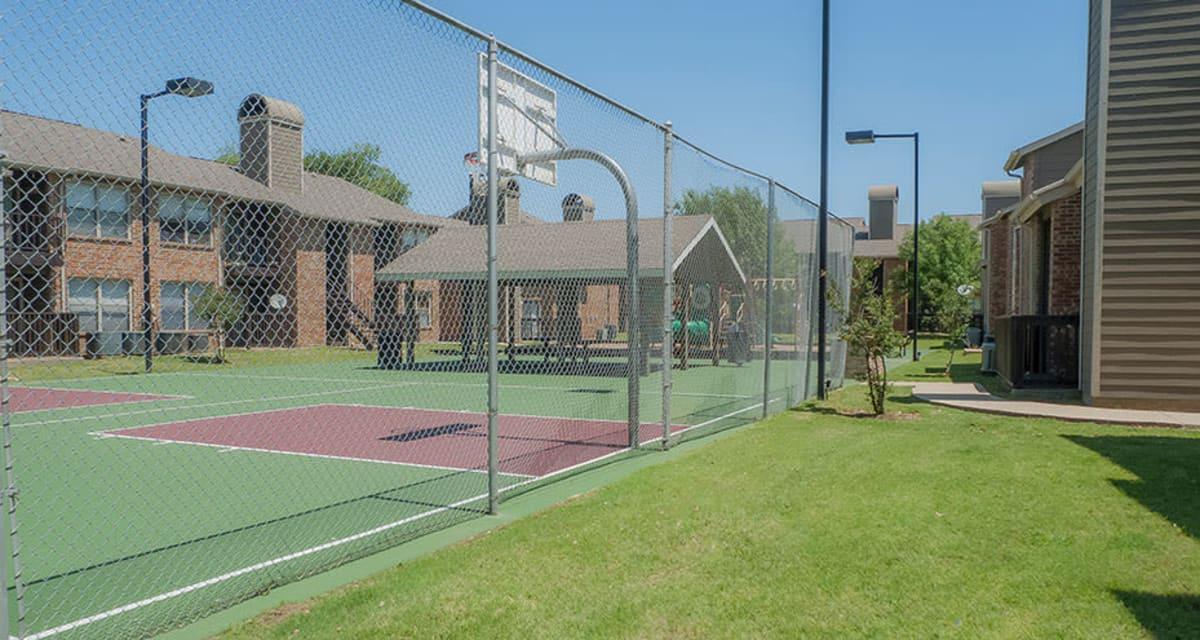 Tennis Court at Greentree Apartments  in  Carrollton, Texas