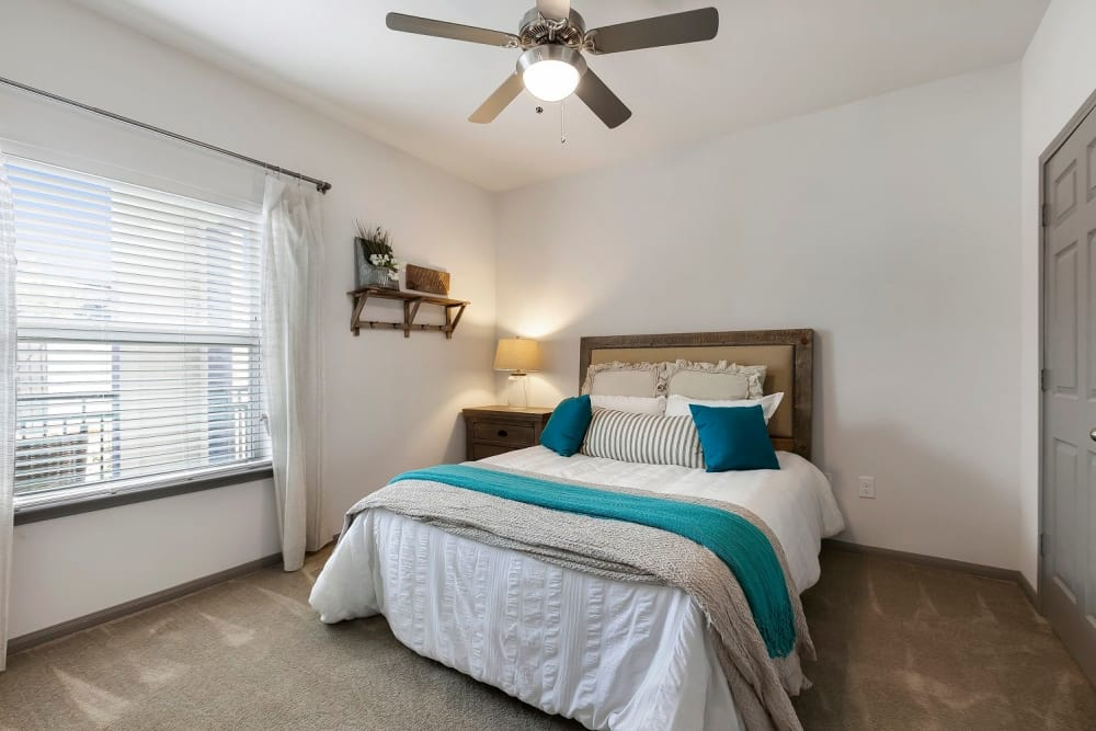 Well lit model bedroom at Plum Creek Vue in Kyle, Texas