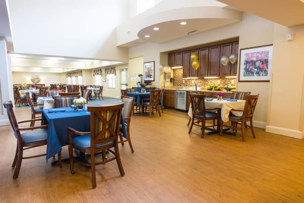 The community kitchen and dining room at The Harmony Collection at Columbia - Independent Living in Columbia, South Carolina