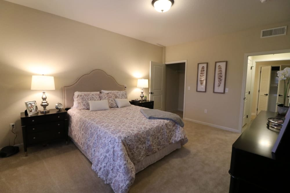 A spacious, decorated bedroom at Harmony at Five Forks in Simpsonville, South Carolina