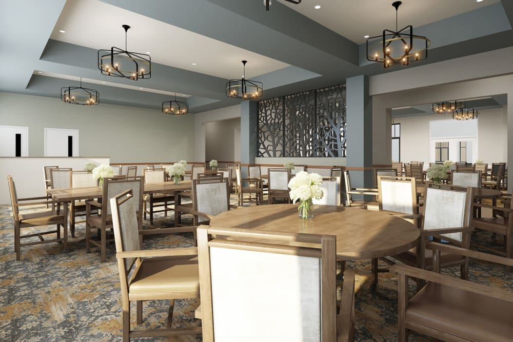 Dining room with flower centerpieces at Anthology of Novi - OPENING 2020 in Novi, Michigan
