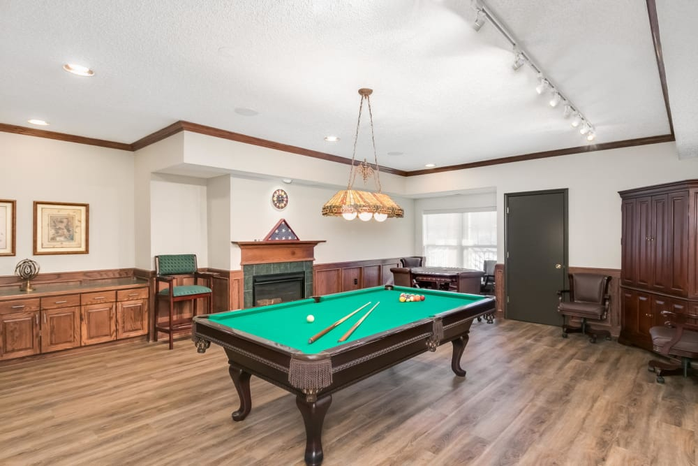 Game room with pool table at Applewood Pointe of Roseville in Roseville, Minnesota.