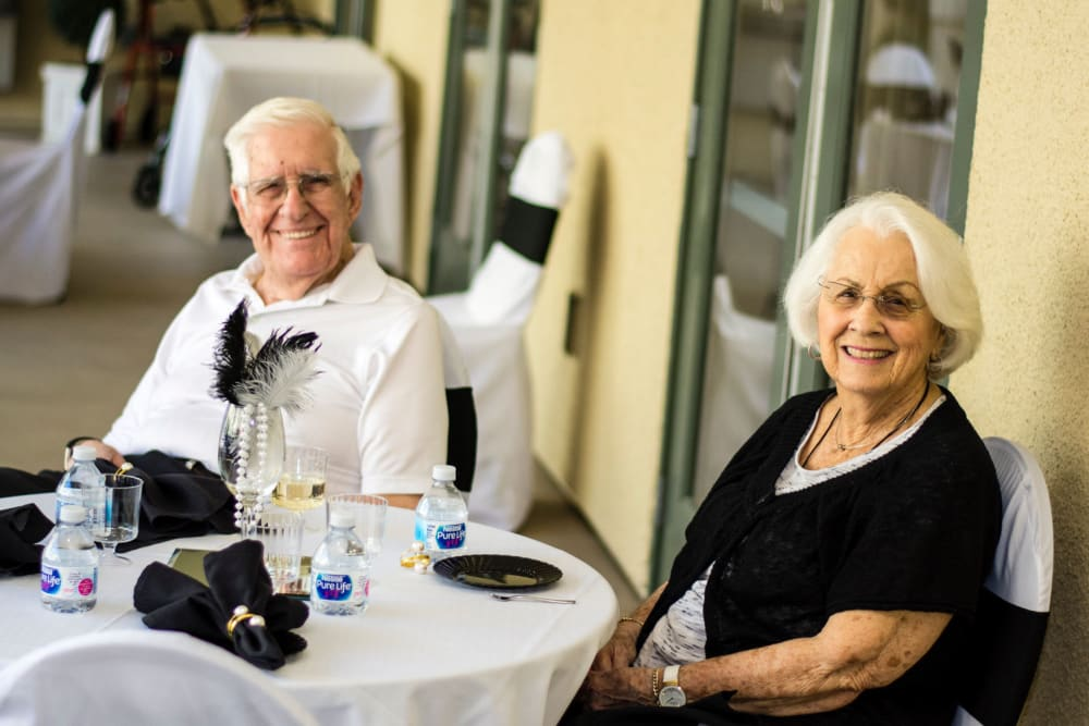 A resident couple enjoying an event at Merrill Gardens at Green Valley Ranch in Henderson, Nevada.