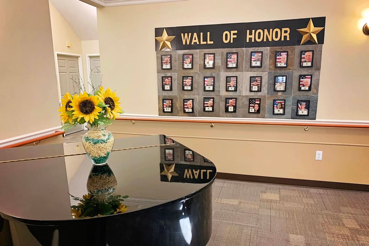 A piano in front of the wall of honor at Farmington Square Salem in Salem, Oregon