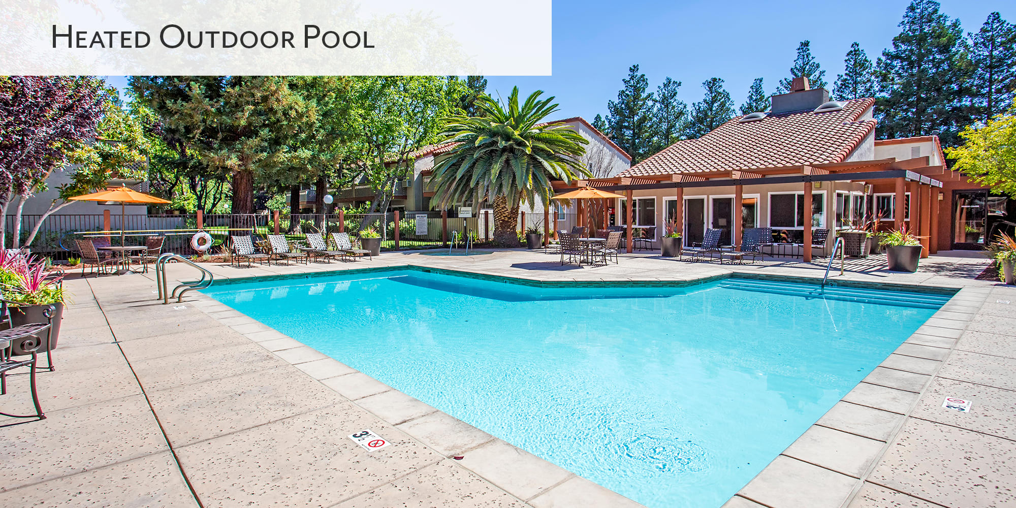 Heated outdoor swimming pool at Valley Plaza Villages in Pleasanton, California
