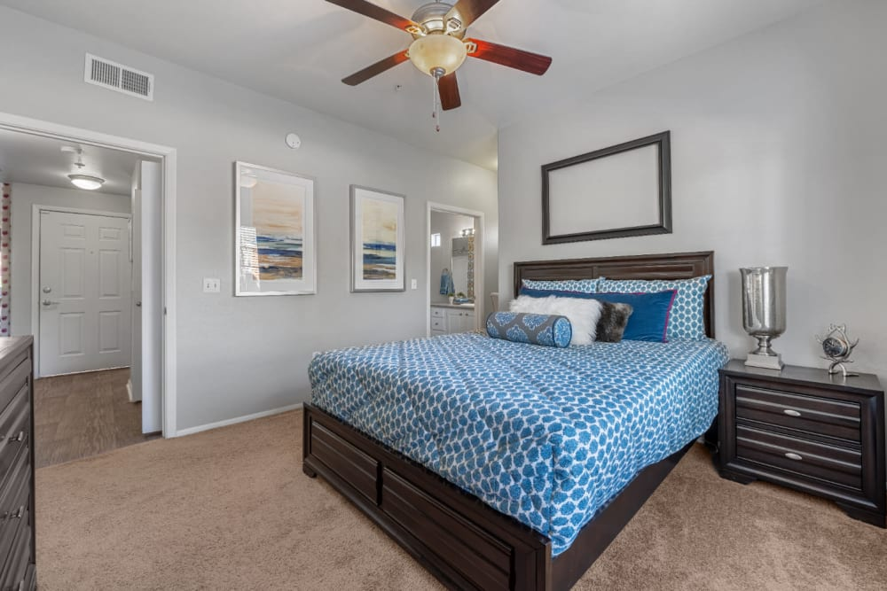 Carpeted bedroom with private bathroom at Alante at the Islands in Chandler, Arizona