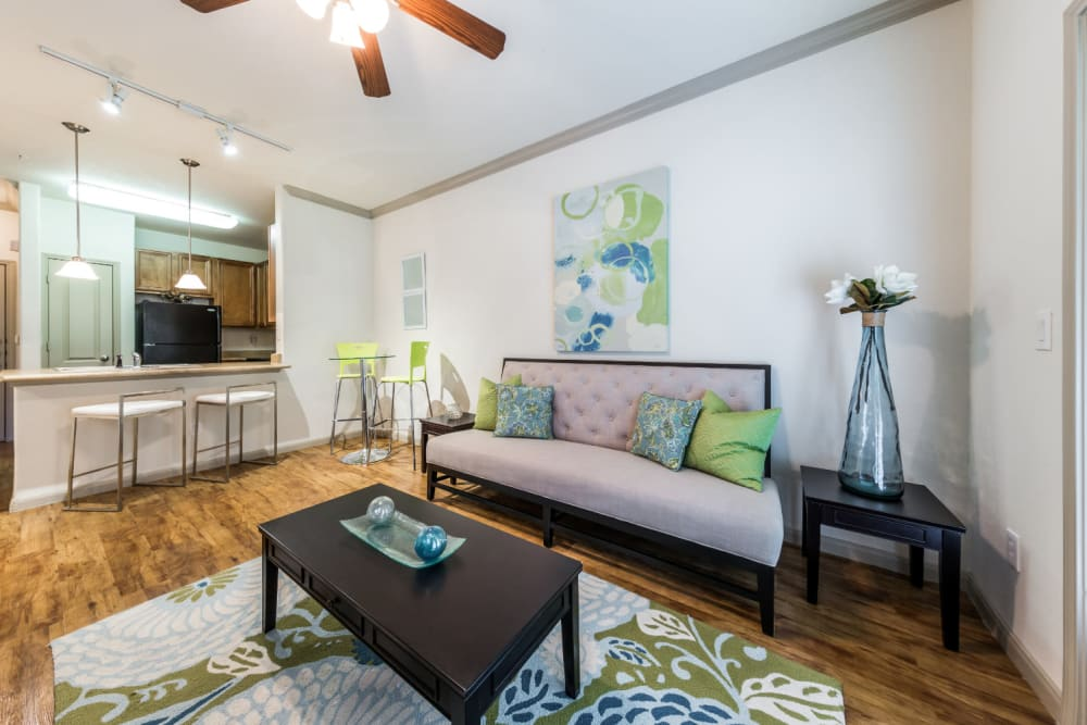 Living area with dining area in corner at Marquis at Clear Lake in Webster, Texas