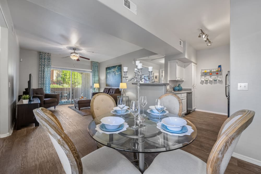 Dining table for four with kitchen and living room in background at Alante at the Islands in Chandler, Arizona
