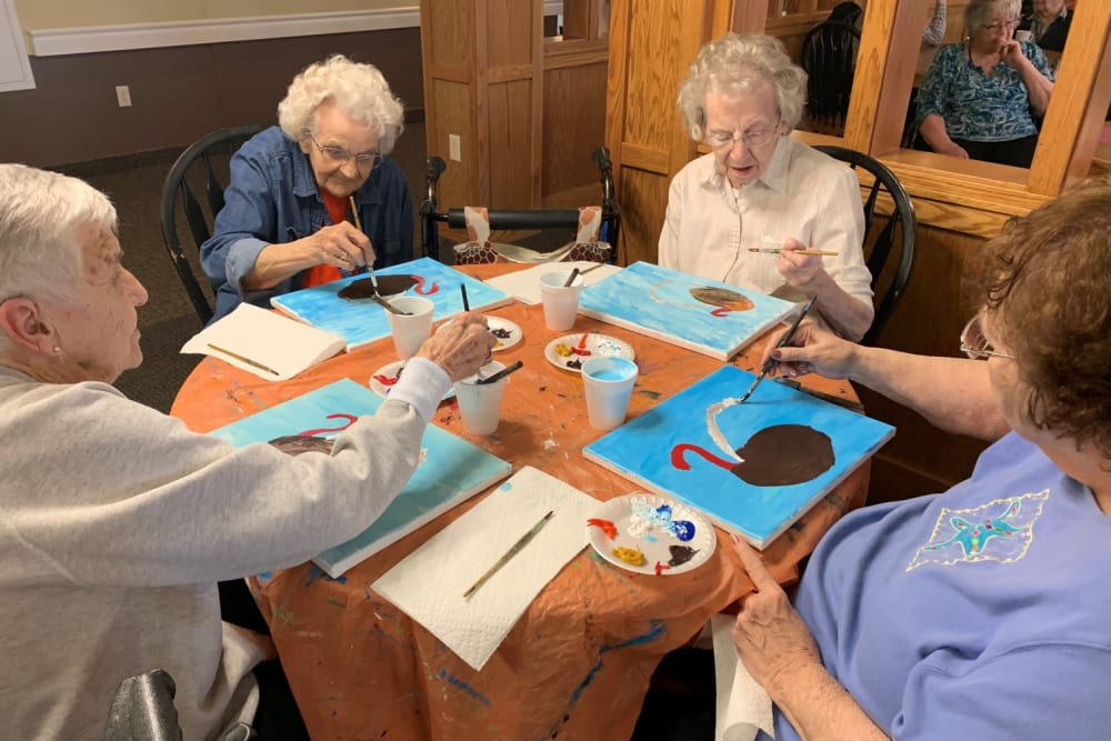 Residents painting at The Wellington in Minot, North Dakota