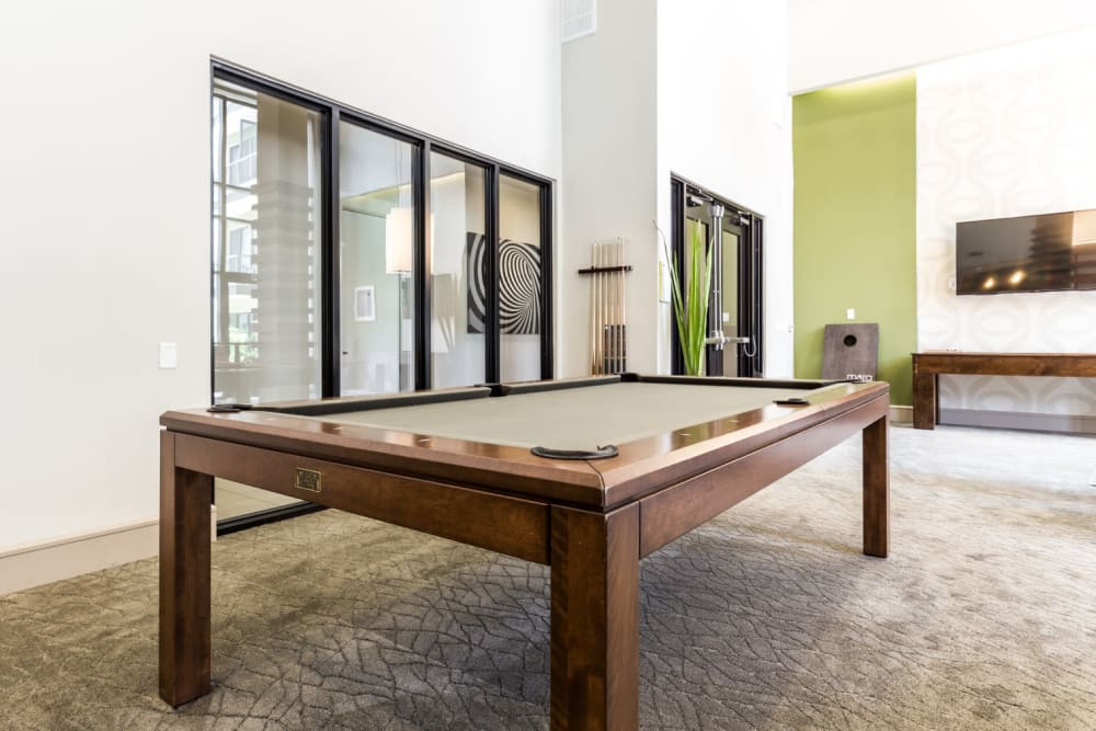 Pool table in game area of community clubhouse at Marq Uptown in Austin, Texas