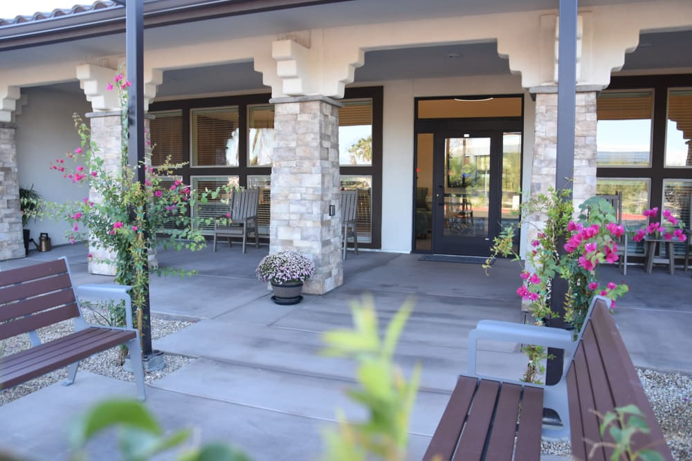 Outdoor patio space with bench seating at Shadow Mountain Memory Care in Phoenix, Arizona