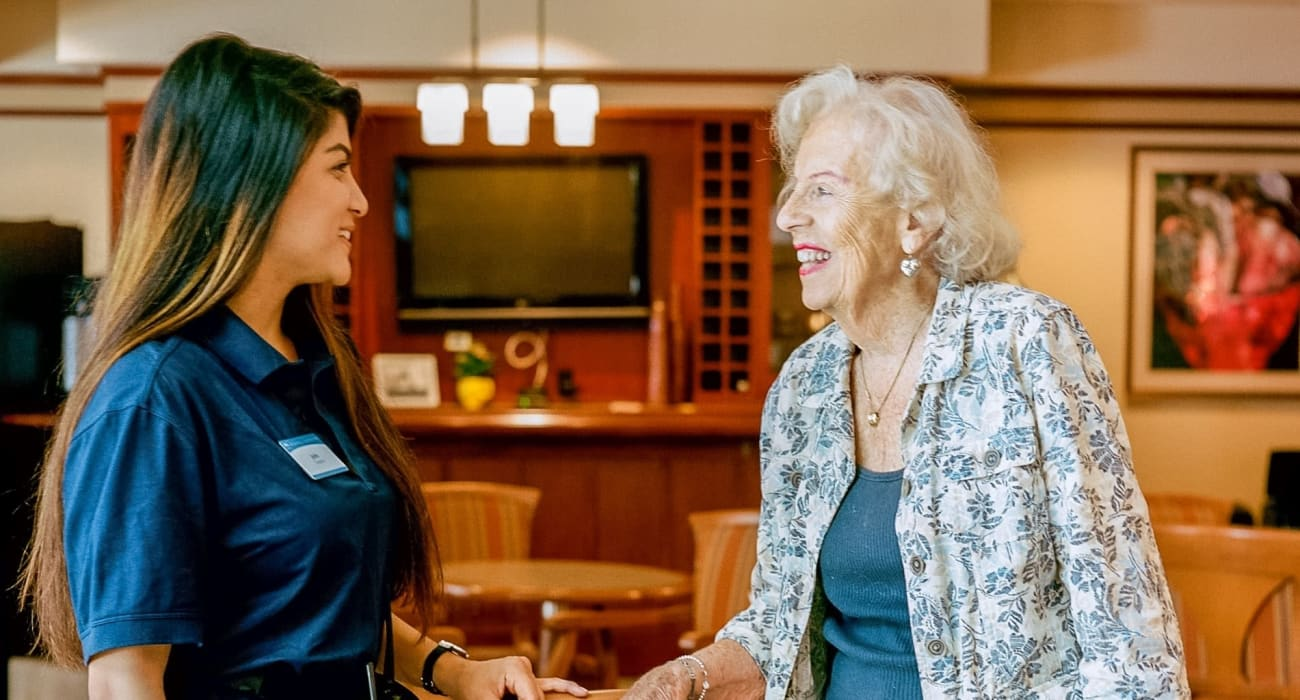 A staff member goes over options with a patient at Merrill Gardens at Rolling Hills Estates in Rolling Hills Estates, California.
