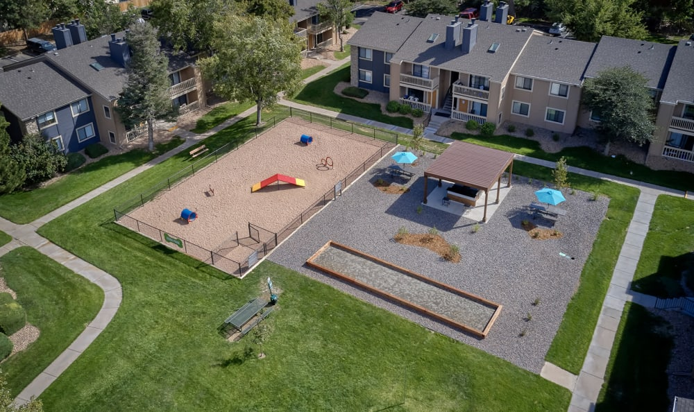 Aerial of exterior amenities and dog park at City Center Station Apartments in Aurora, Colorado
