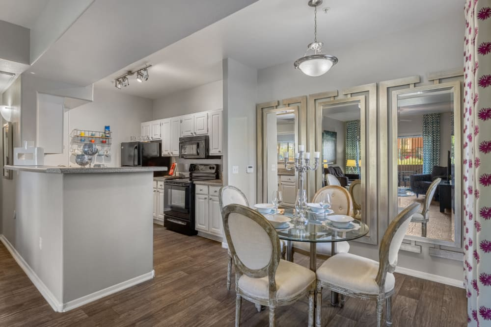 Dining table for four with kitchen in background at Alante at the Islands in Chandler, Arizona