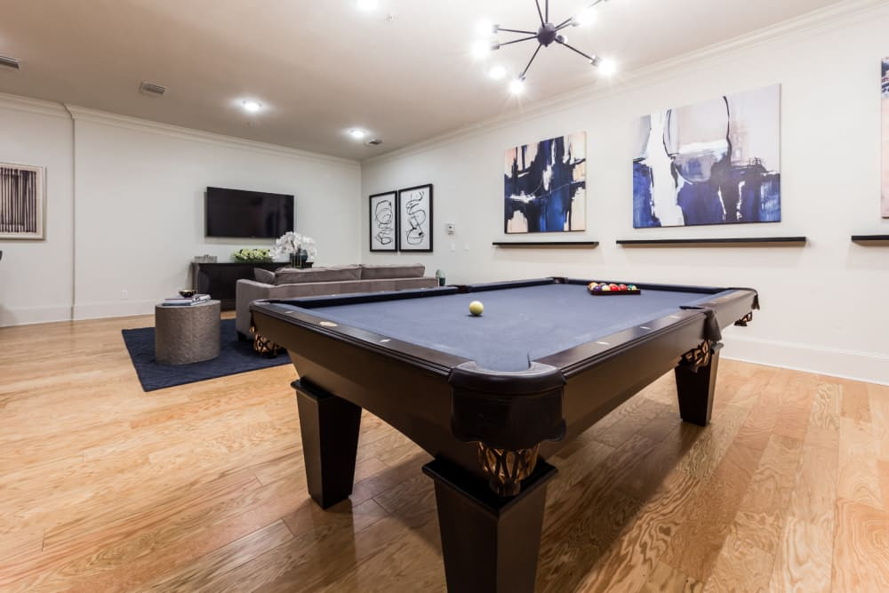 Pool table in clubhouse entertainment room at Marquis at The Cascades in Tyler, Texas