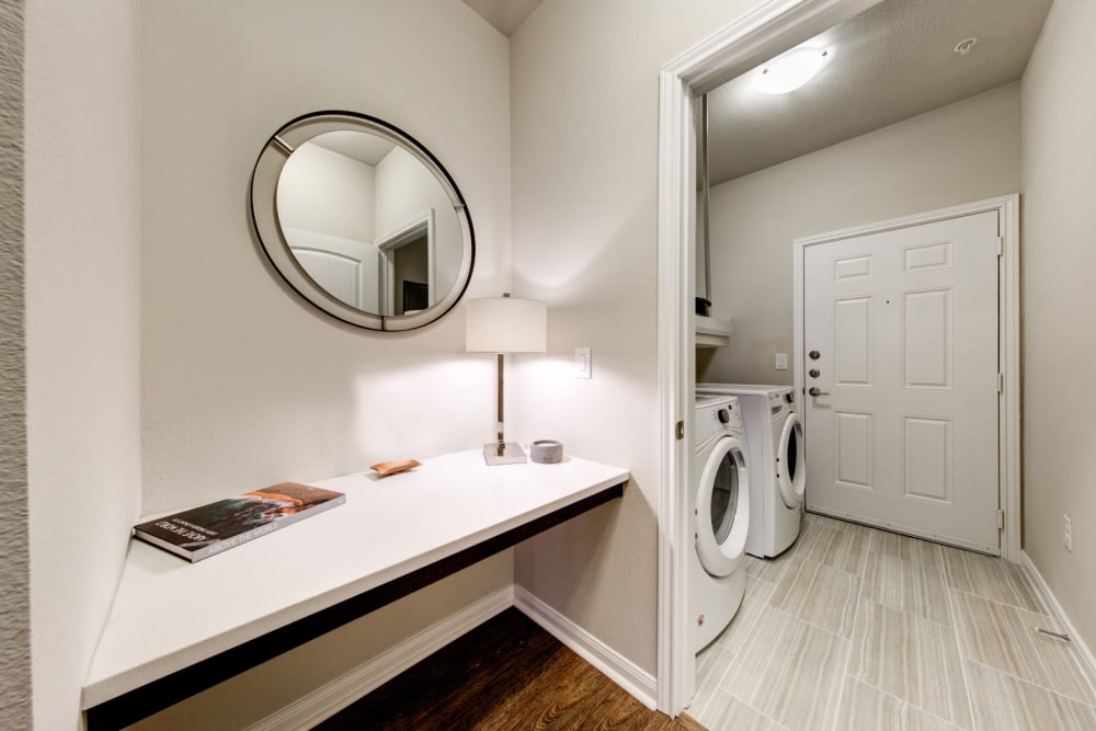 Washer and dryer area at Marquis at Cinco Ranch in Katy, Texas