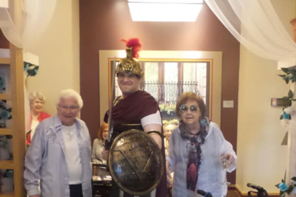 Guests pose for photo with Greek warrior at All Seasons of Birmingham in Birmingham, Michigan