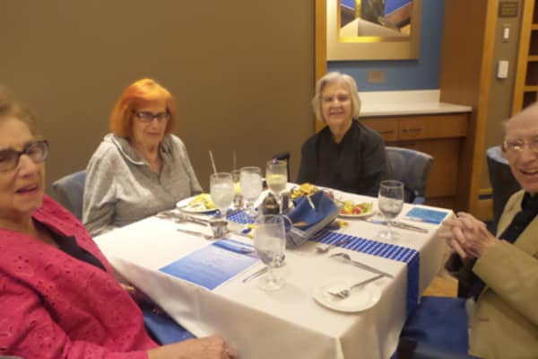 Guest dine during Sail the Greek Isles event at All Seasons of Birmingham in Birmingham, Michigan