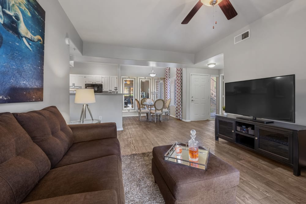 Well-decorated living space with wood style flooring at Alante at the Islands in Chandler, Arizona