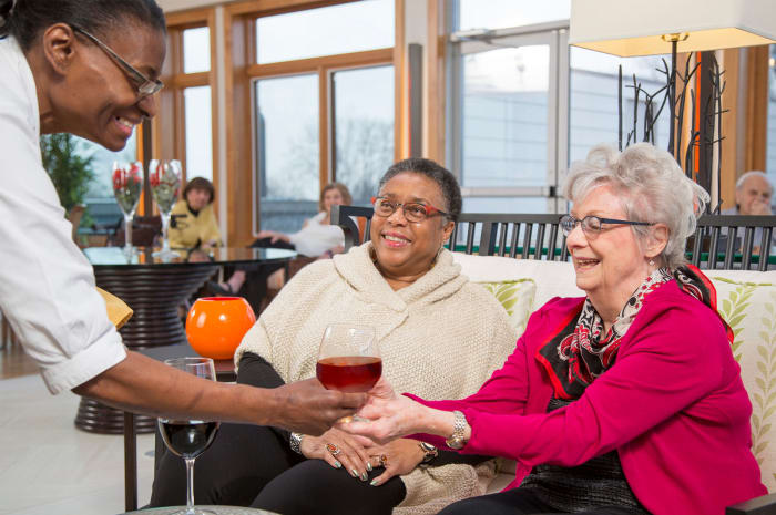 Residents getting served beverages at All Seasons of Birmingham in Birmingham, Michigan