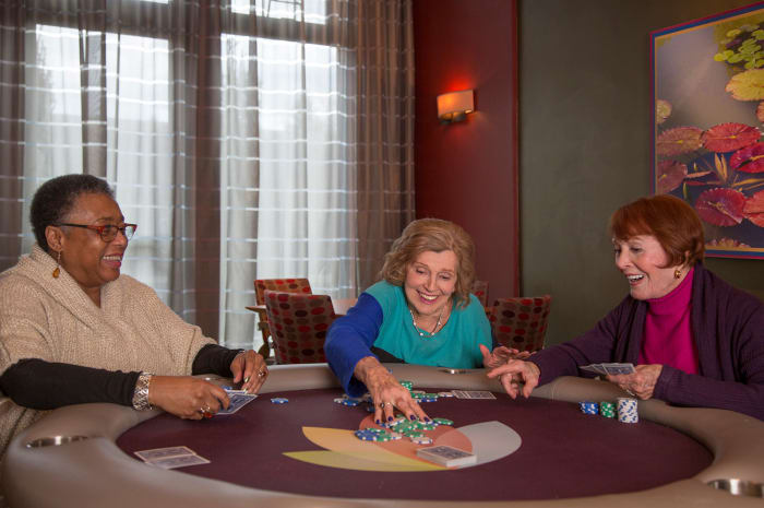 Residents enjoying a game night at All Seasons Naples in Naples, Florida