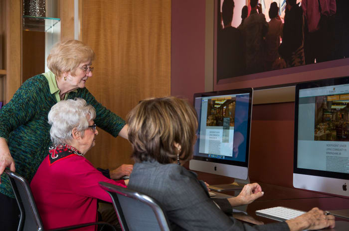 Residents spending time on computers at All Seasons of Birmingham in Birmingham, Michigan